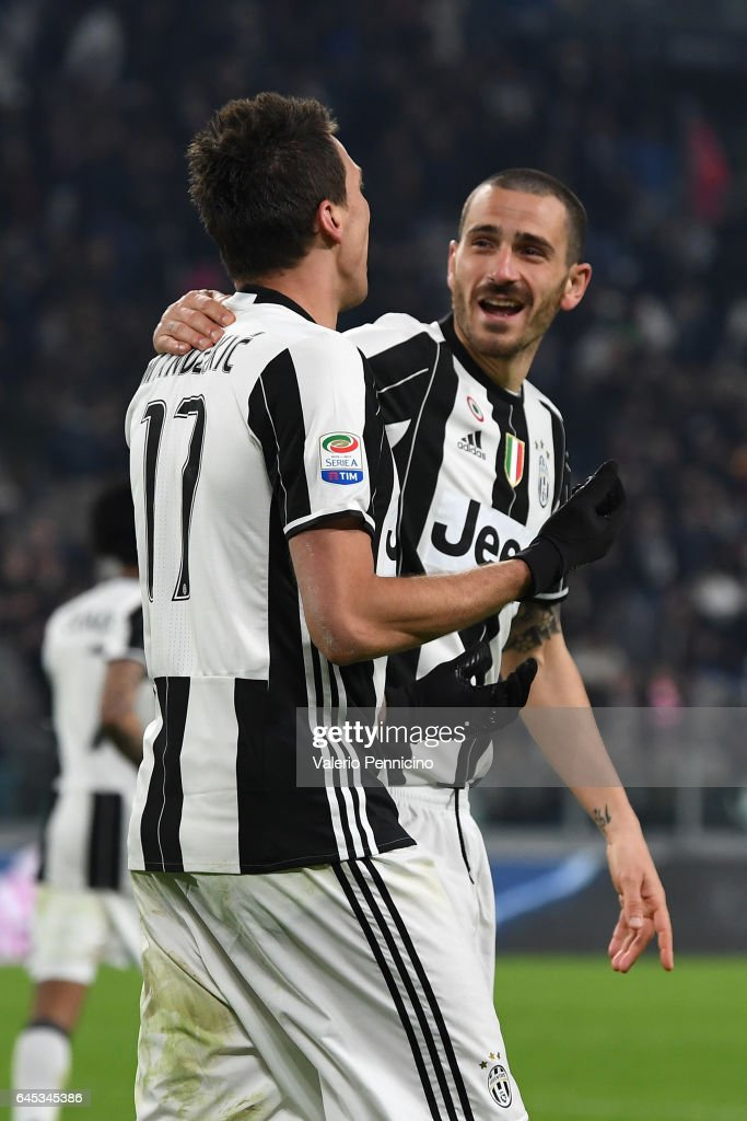 Mario Mandzukic (L) of Juventus FC celebrates after scoring the opening goal with team mate Leonardo Bonucci during the Serie A match between Juventus FC and Empoli FC at Juventus Stadium on February 25, 2017 in Turin, Italy.