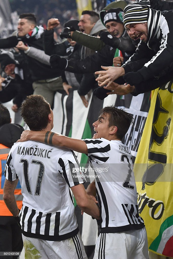 Mario Mandzukic (L) of Juventus FC celebrates his goal with team mate Paulo Dybala during the Serie A match betweeen Juventus FC and ACF Fiorentina at Juventus Arena on December 13, 2015 in Turin, Italy.