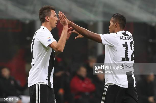 Mario Mandzukic of Juventus FC celebrates with his teammates Alex Sandro after scoring the opening goal during the Serie A match between AC Milan and...