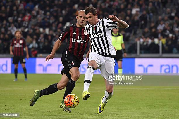 Mario Mandzukic of Juventus FC in action against Alex of AC Milan during the Serie A match between Juventus FC and AC Milan at Juventus Arena on...