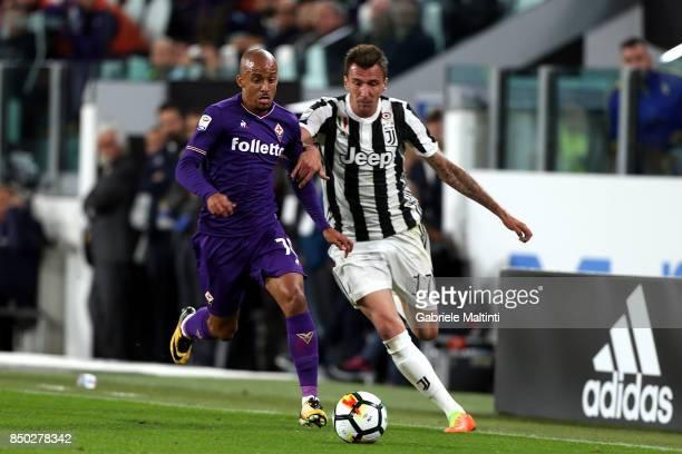 Mario Mandzukic of Juventus FC in action against Bruno Gaspar of ACF Fiorentina during the Serie A match between Juventus and ACF Fiorentina on...