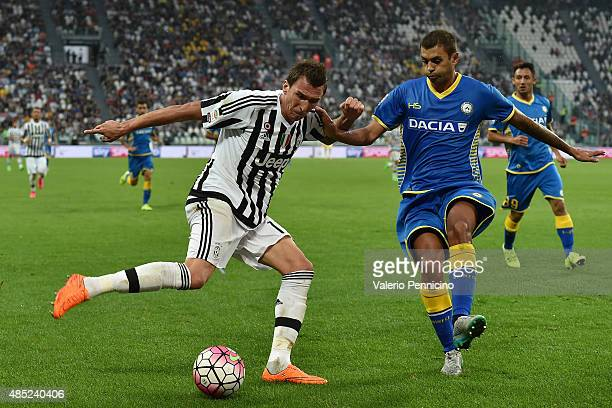 Mario Mandzukic of Juventus FC in action against Danilo Larangeira of Udinese Calcio during the Serie A match between Juventus FC and Udinese Calcio...