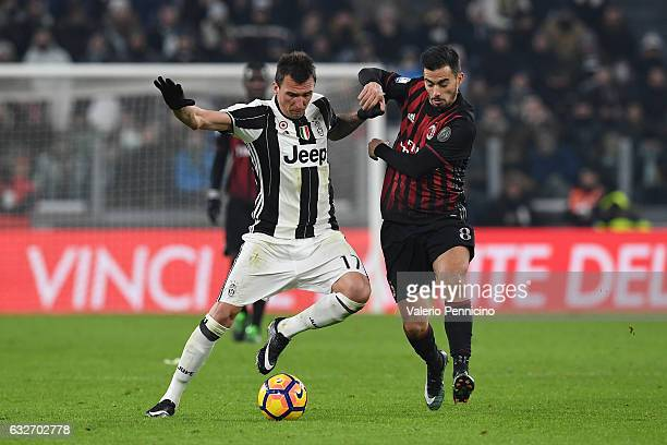 Mario Mandzukic of Juventus FC is challenged by Fernandez Suso of AC Milan during the TIM Cup match between Juventus FC and AC Milan at Juventus...