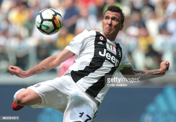 Mario Mandzukic of Juventus FC kicks the ball during the serie A match between Juventus and Hellas Verona FC at Allianz Stadium on May 19, 2018 in...