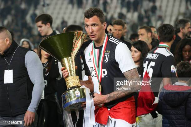 Mario Mandzukic of Juventus FC with the trophy of Scudetto during the victory ceremony following the Italian Serie A last football match of the...