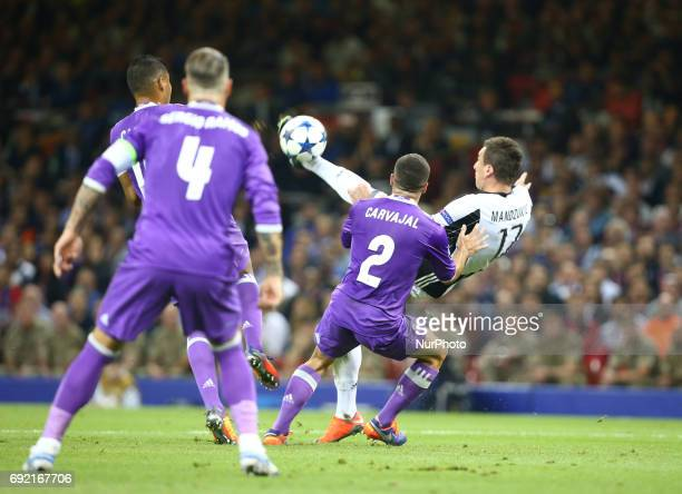 Mario Mandzukic of Juventus FCscores his sides equalising goal to make the score 11 during the UEFA Champions League Final match between Real Madrid...