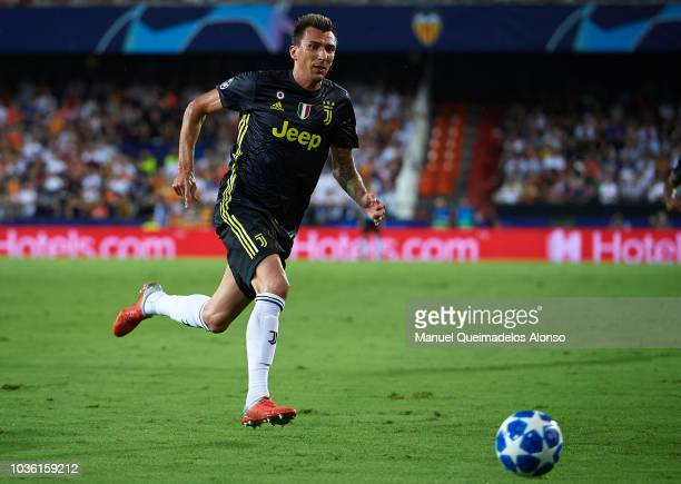 Mario Mandzukic of Juventus in action during the Group H match of the UEFA Champions League between Valencia and Juventus at Estadio Mestalla on...