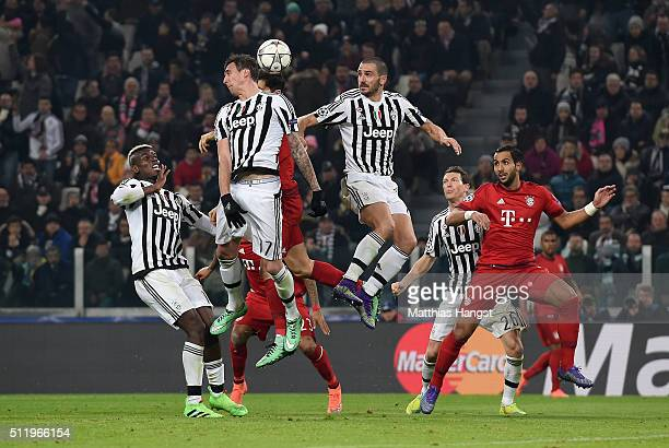 Mario Mandzukic of Juventus jumps for a header with Joshua Kimmich of Muenchen during the UEFA Champions League Round of 16 first leg match between...
