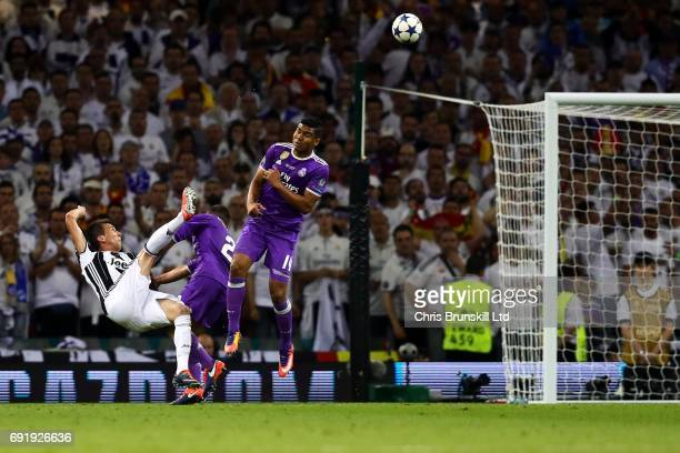 Mario Mandzukic of Juventus scores his side's first goal during the UEFA Champions League Final match between Juventus and Real Madrid at the...