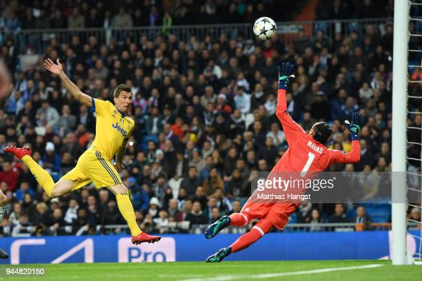 Mario Mandzukic of Juventus scores his sides first goal during the UEFA Champions League Quarter Final Second Leg match between Real Madrid and...