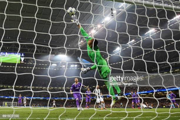 Mario Mandzukic of Juventus scores his sides first goal past Keylor Navas of Real Madrid during the UEFA Champions League Final between Juventus and...