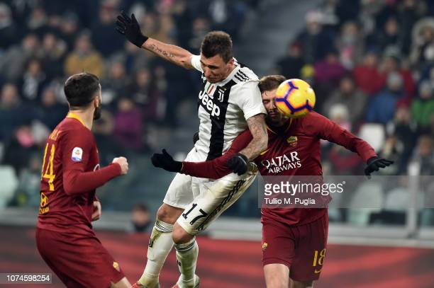 Mario Mandzukic of Juventus scores the opening goal during the Serie A match between Juventus and AS Roma on December 22 2018 in Turin Italy