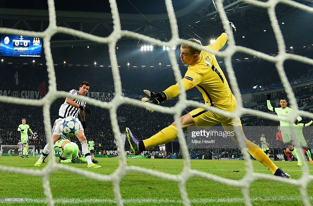 Mario Mandzukic of Juventus scores the opening goal past the outstretched Joe Hart of Manchester City during the UEFA Champions League group D match between Juventus and Manchester City FC at the Juventus Stadium on November 25, 2015 in Turin, Italy.