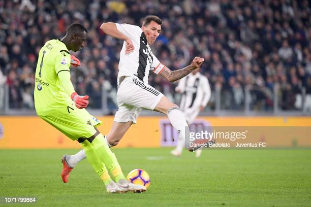 Mario Mandzukic of Juventus tackles Alfred Gomis of Spal during the Serie A match between Juventus and SPAL at Allianz Stadium on November 24 2018 in...