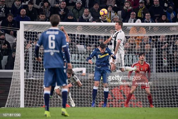 Mario Mandzukic of Juventus wins a header over Andrea Petagna of Spal during the Serie A match between Juventus and SPAL at Allianz Stadium on...