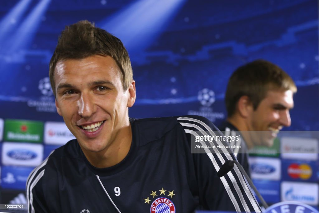 Mario Mandzukic (L) of Muenchen arrives with his team mate Philipp Lahm for a FC Bayern Muenchen press conference ahead of their UEFA Champions League group F match against Valencia CF at the Saebener Strasse training ground on September 18, 2012 in Munich, Germany.