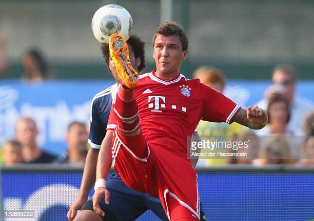 Mario Mandzukic of Muenchen battels for the ball with Dennis Curt Yeboah of the Traumelf during a friendly match between Paulaner Traumelf and FC...