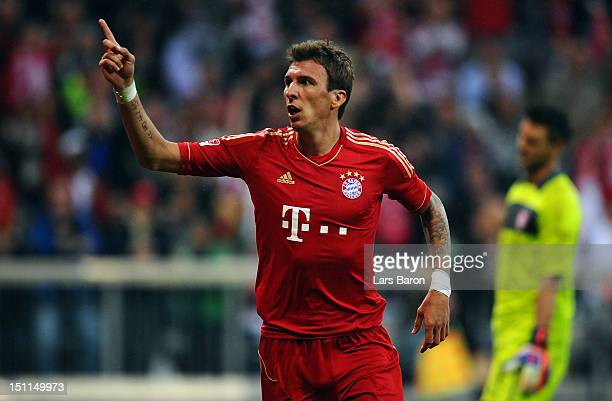 Mario Mandzukic of Muenchen celebrates after scoring hia teams fourth goal during the Bundesliga match between FC Bayern Muenchen and VfB Stuttgart...
