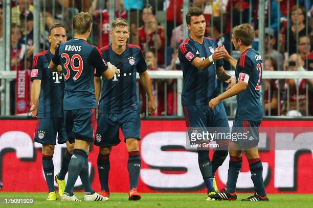 Mario Mandzukic of Muenchen celebrates his team's first goal with team mates Philipp Lahm, Bastian Schweinsteiger, Toni Kroos and Franck Ribery...