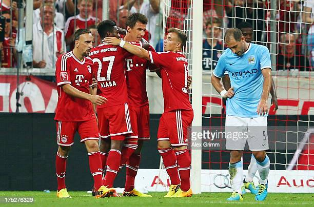 Mario Mandzukic of Muenchen celebrates his team's second goal with team mates during the Audi Cup Final match between FC Bayern Muenchen and...
