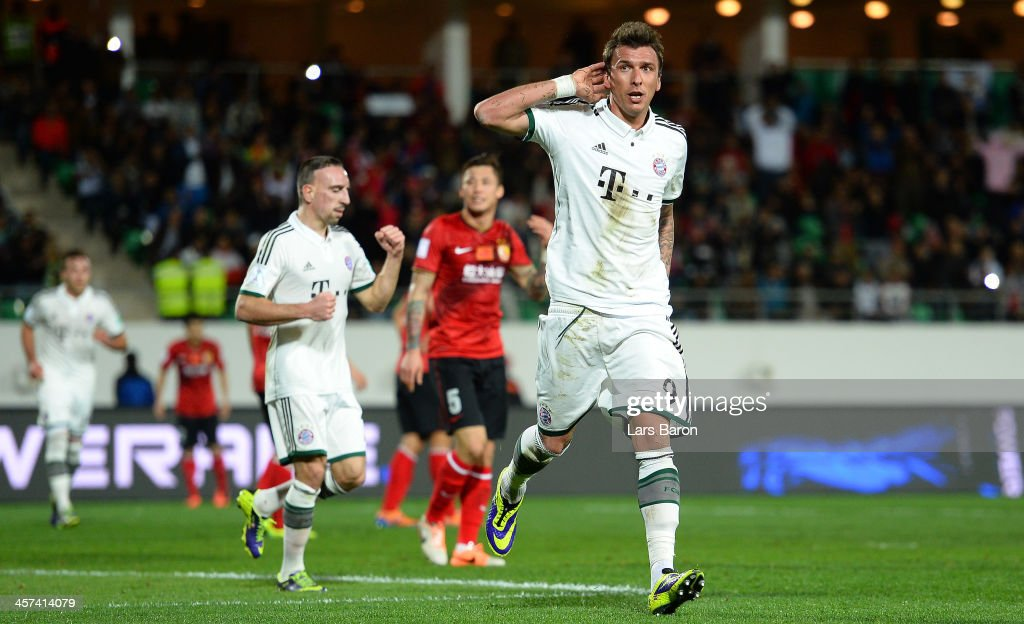 Mario Mandzukic of Muenchen celebrates next to Franck Ribery atfer scoring his teams first goal during the FIFA Cub World Cup semifinal match between Guangzhou Evergrande and Bayern Muenchen at Agadir Stadium on December 17, 2013 in Agadir, Morocco.
