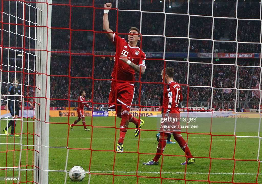 Mario Mandzukic of Muenchen celebrates scoring the opening goal during the Bundesliga match between FC Bayern Muenchen and Hamburger SV at Allianz Arena on September 28, 2013 in Munich, Germany.