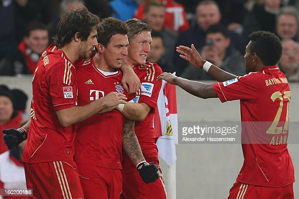 Mario Mandzukic of Muenchen celebrates scoring the opening goal with his team mates Javi Martinez , Bastian Schweinteiger and David Alaba during the...