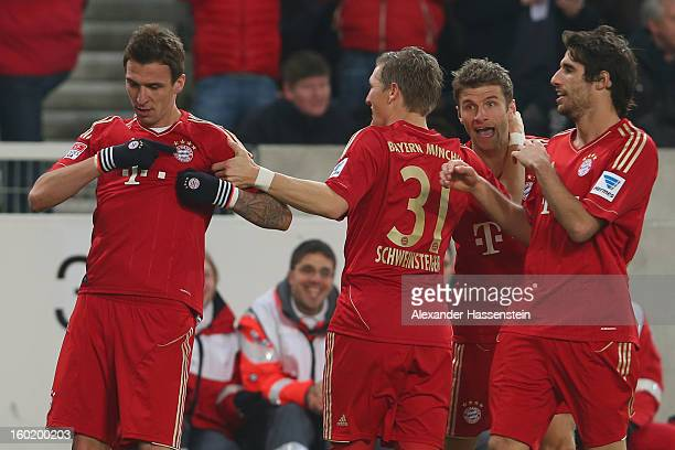 Mario Mandzukic of Muenchen celebrates scoring the opening goal with his team mates Javi Martinez Bastian Schweinteiger and Thomas Mueller during the...