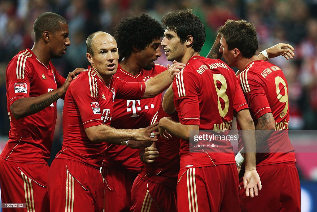 Mario Mandzukic (R) of Muenchen celebrates with his team mates after scoring his team's second goal during the Bundesliga match between FC Bayern Muenchen and VfL Wolfsburg at Allianz Arena on September 25, 2012 in Munich, Germany.