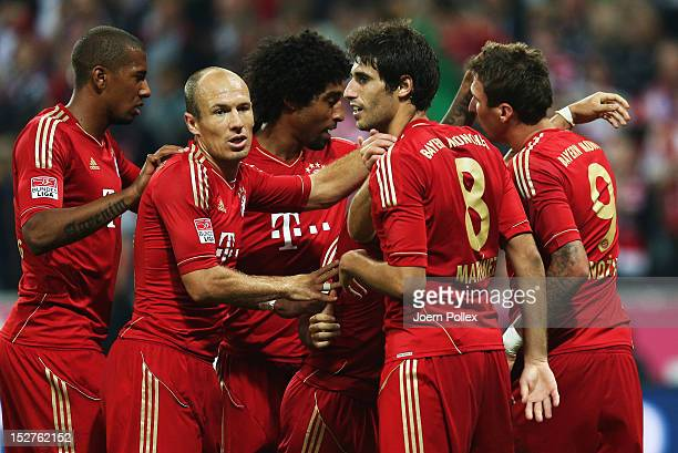 Mario Mandzukic of Muenchen celebrates with his team mates after scoring his team's second goal during the Bundesliga match between FC Bayern...