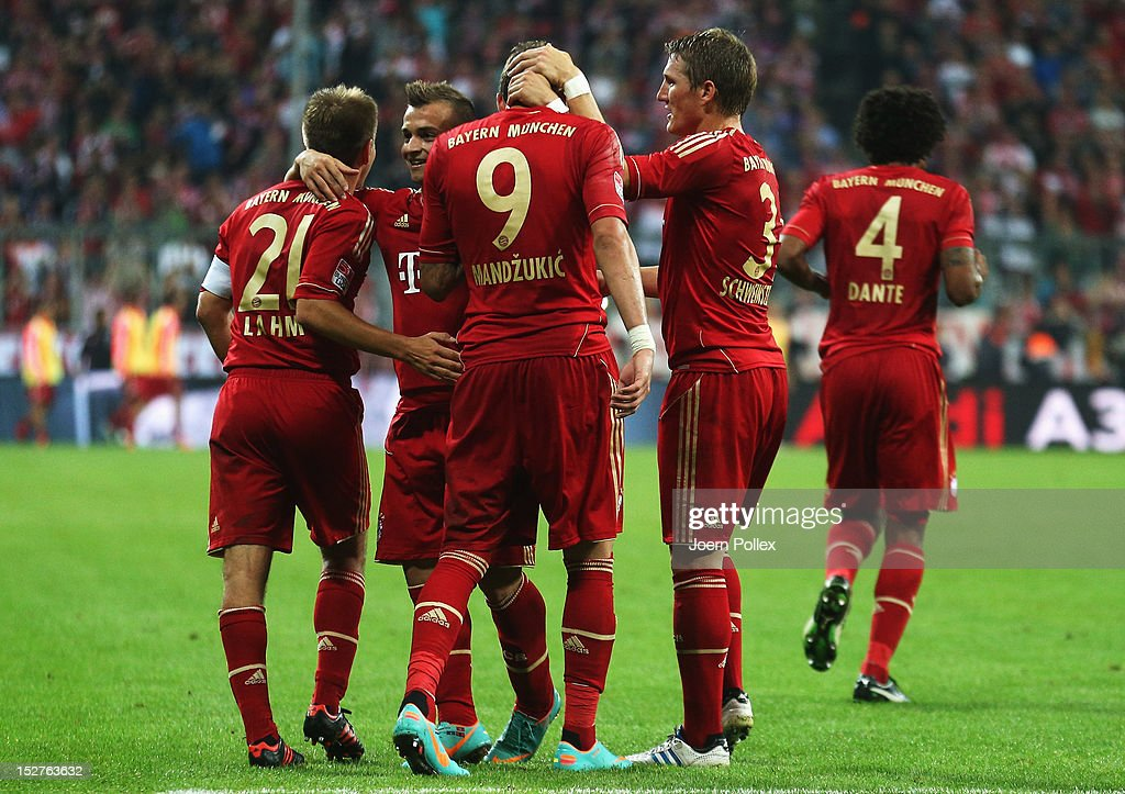 Mario Mandzukic (C) of Muenchen celebrates with his team mates after scoring his team's third goal during the Bundesliga match between FC Bayern Muenchen and VfL Wolfsburg at Allianz Arena on September 25, 2012 in Munich, Germany.