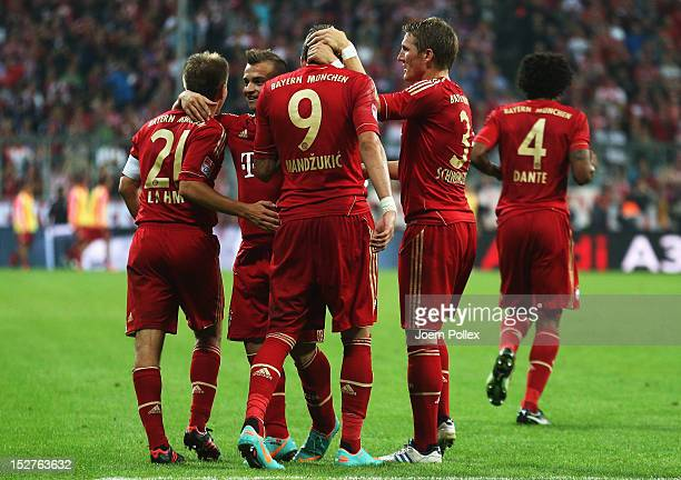 Mario Mandzukic of Muenchen celebrates with his team mates after scoring his team's third goal during the Bundesliga match between FC Bayern Muenchen...