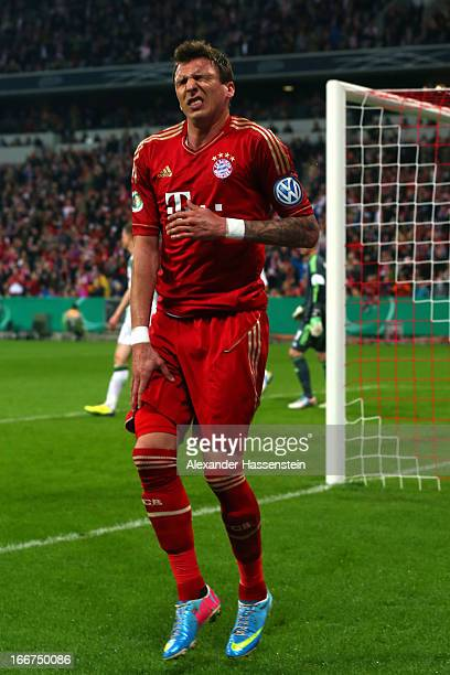 Mario Mandzukic of Muenchen reacts after scoring the opening goal during the DFB Cup Semi Final match between Bayern Muenchen and VfL Wolfsburg at...