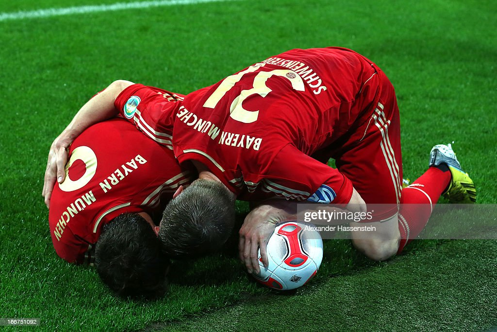 Mario Mandzukic (L) of Muenchen reacts with his team mate Bastian Schweinsteiger after scoring the opening goal during the DFB Cup Semi Final match between Bayern Muenchen and VfL Wolfsburg at Allianz Arena on April 16, 2013 in Munich, Germany.