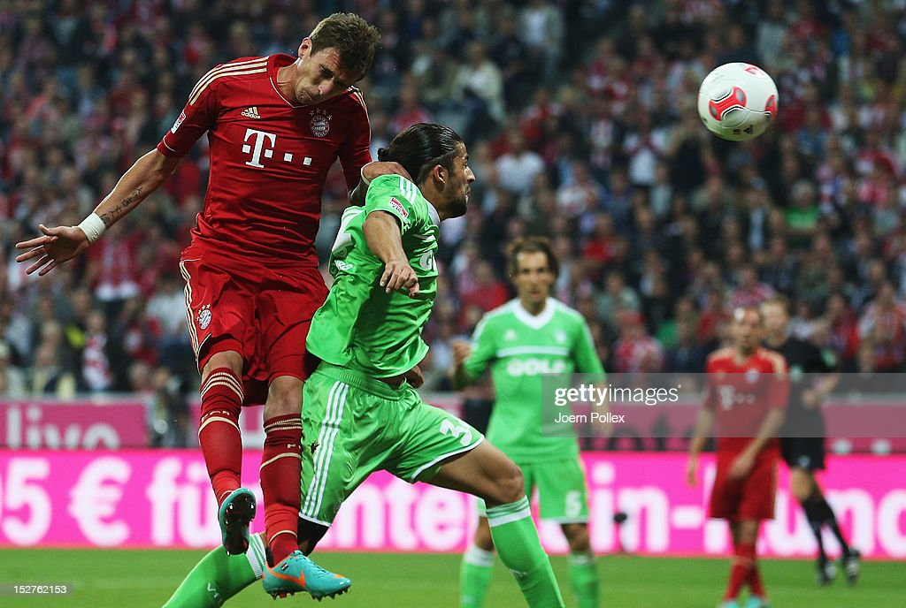 Mario Mandzukic (L) of muenchen scores his team's second goal during the Bundesliga match between FC Bayern Muenchen and VfL Wolfsburg at Allianz Arena on September 25, 2012 in Munich, Germany.