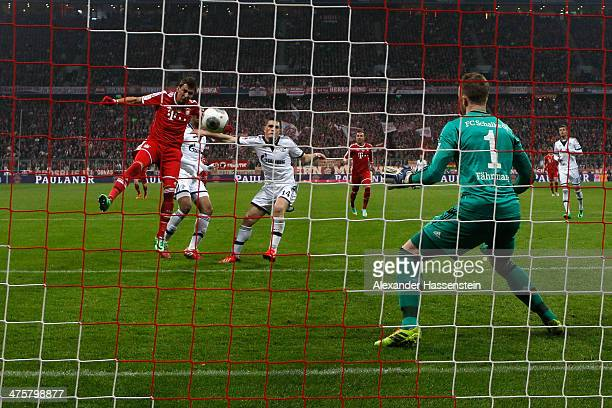 Mario Mandzukic of Muenchen scores the 3rd team goal against Ralf Faehrmann keeper of Schalke during the Bundesliga match between FC Bayern Muenchen...