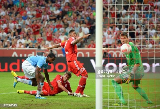 Mario Mandzukic of Muenchen scores the second goal during the Audi cup 2013 final between FC Bayern Muenchen and Manchester City at Allianz Arena on...