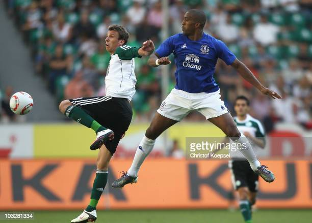Mario Mandzukic of Wolfsburg and Sylvain Distin of Everton go up for a header during the pre-season friendly match between VfL Wolfsburg and Everton...