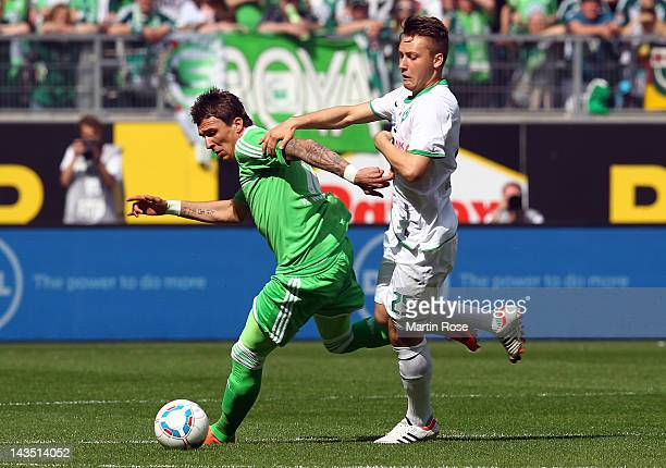 Mario Mandzukic of Wolfsburg and Tom Trybull of Bremen battle for the ball during the Bundesliga match between VfL Wolfsburg and SV Werder Bremenat...