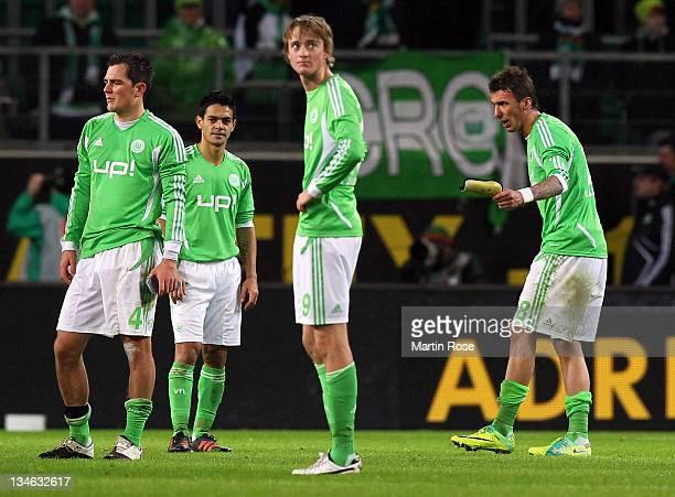 Mario Mandzukic of Wolfsburg argues with his team mates Marcel Schaefer joseu and Bjarne Thoelke during the Bundesliga match between VfL Wolfsburg...