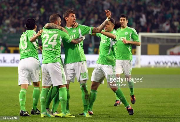 Mario Mandzukic of Wolfsburg celebrate with his team mates after he heads his team's opening goal during the Bundesliga match between VfL Wolfsburg...