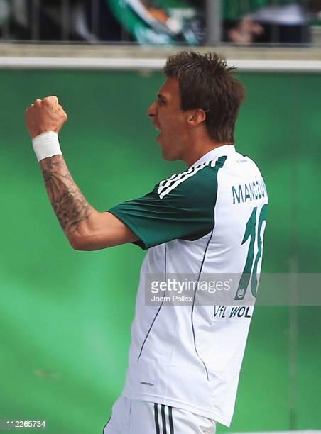 Mario Mandzukic of Wolfsburg celebrates after scoring his team's first goal during the Bundesliga match between VfL Wolfsburg and FC St. Pauli at...