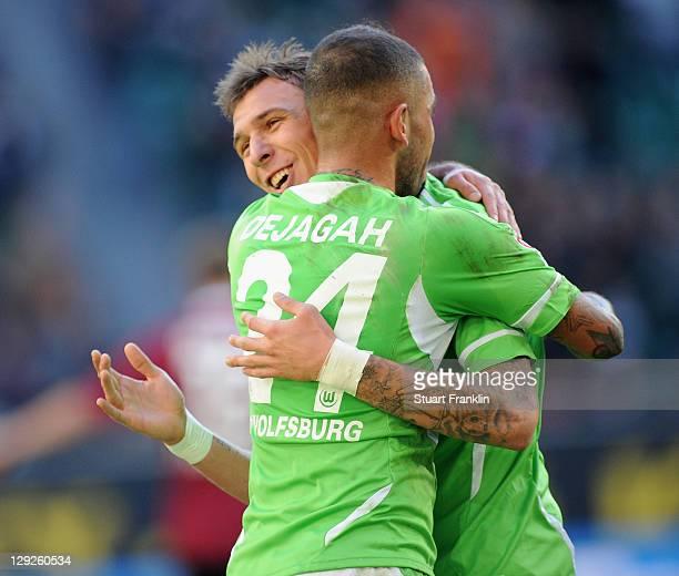 Mario Mandzukic of Wolfsburg celebrates scoring the first goal with Ashkan Dejagah during the Bundesliga match between VfL Wolfsburg and 1 FC...