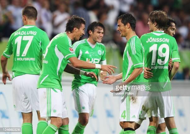 Mario Mandzukic of Wolfsburg celebrates with his team mate Marcel Schaefer after scoring his team's second goalduring the Bundesliga match between...