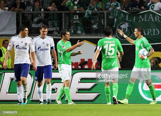 Mario Mandzukic of Wolfsburg celebrates with his team mates after scoring his team's first goalduring the Bundesliga match between VfL Wolfsburg and...