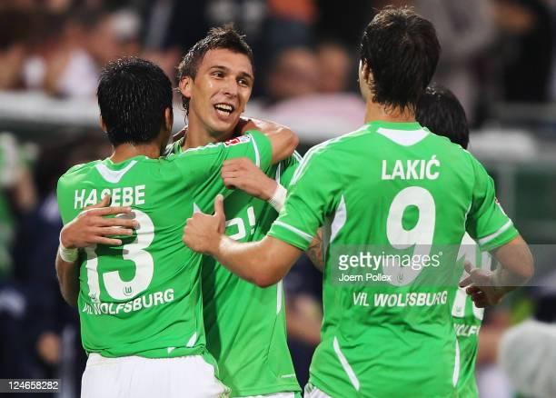 Mario Mandzukic of Wolfsburg celebrates with his team mates after scoring his team's second goalduring the Bundesliga match between VfL Wolfsburg and...