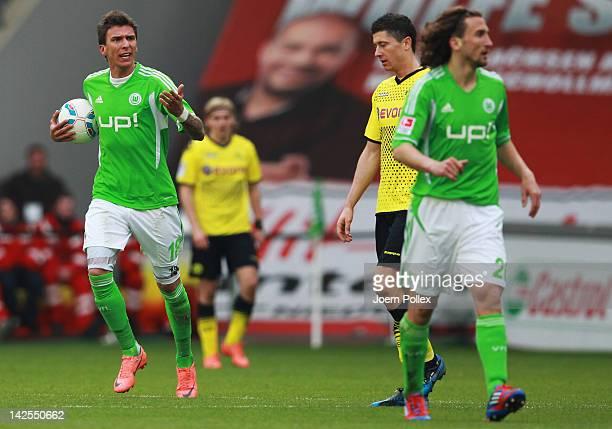 Mario Mandzukic of Wolfsburg gestures after scoring his team's first goal during the Bundesliga match between VfL Wolfsburg and Borussia Dortmund at...