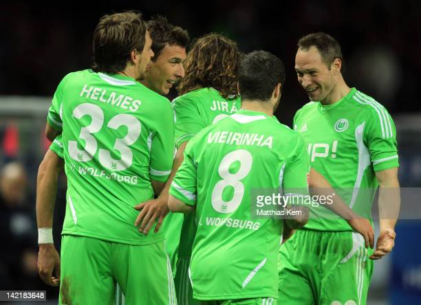 Mario Mandzukic of Wolfsburg jubilates with team mates after scoring the fourth goal during the Bundesliga match between Hertha BSC Berlin and VFL...