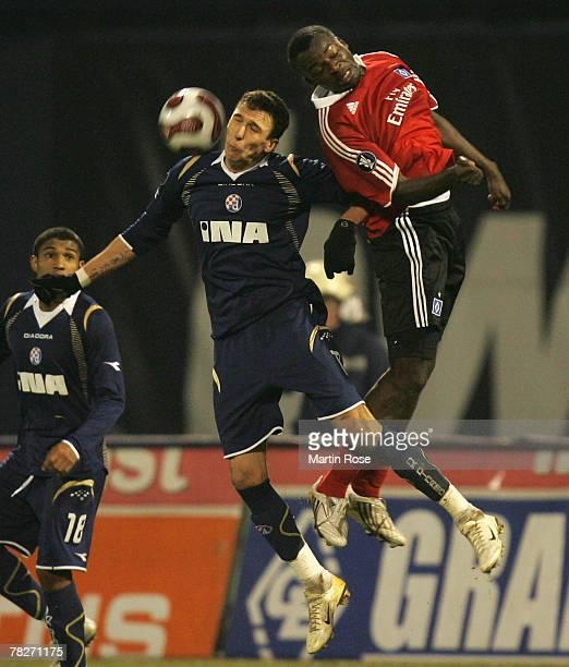 Mario Mandzukic of Zagreb and Thimothee Atouba of Hamburg jump for a header during the UEFA Cup Group D match between Dinamo Zagreb and Hamburger SV...