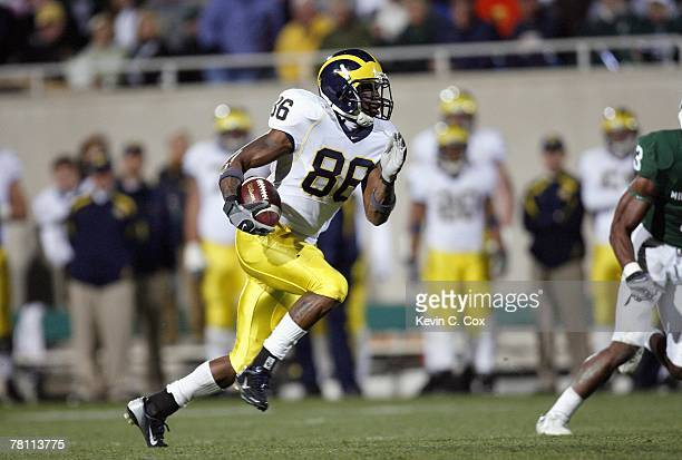 Mario Manningham of the Michigan Wolverines carries the ball during the game against the Michigan State Spartans at Spartan Stadium November 3, 2007...